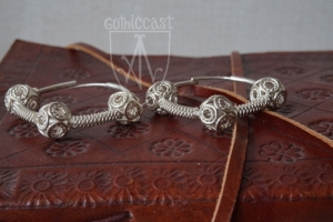 Earrings desighned by the Slavic. Three beads temple rings of 10-12th century