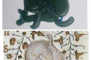 Medieval badge cat