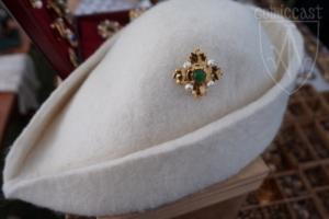 Megi brooch with green onyx on hat