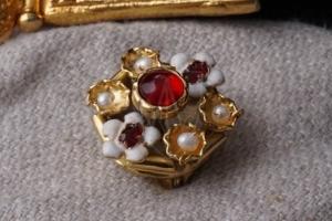 Burgundy brooch with enamel
