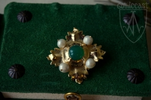 Megi brooch with green onyx on the book