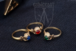 Ring with quatrefoil stoneplace brass